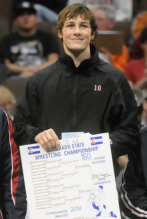 Roosevelt High School senior Blake Nygren stands on the podium after receiving his medal for defeating Northridge's Robert Pickrell in the Class 4A 160-pound final match of the State Wrestling Championships on Saturday at the Pepsi Center in Denver.