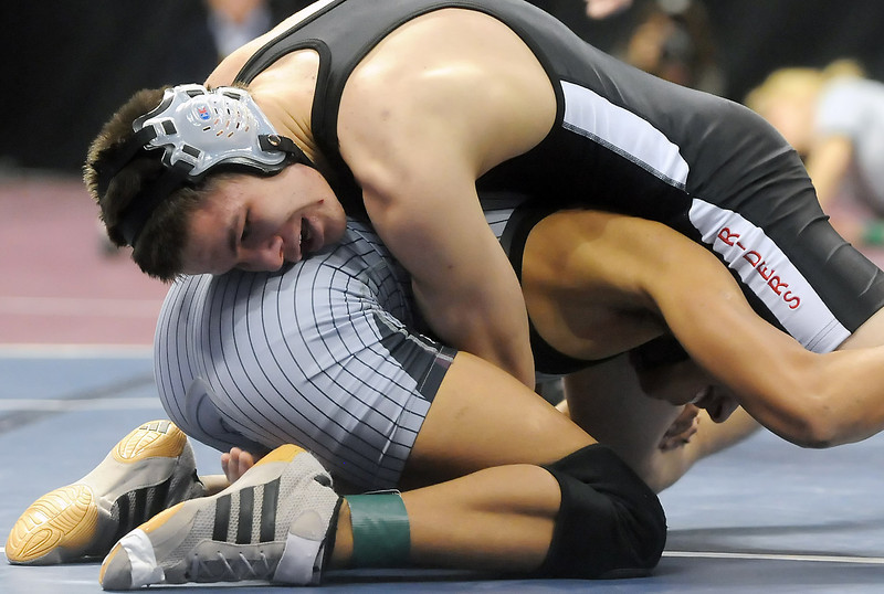 Roosevelt High School junior Chris Walker, top, wrestles with Alex Gonzalez of Silver Creek during their 119-pound match at the State Wrestling Championships on Thursday, Feb. 18, 2010 at the Pepsi Center in Denver.
