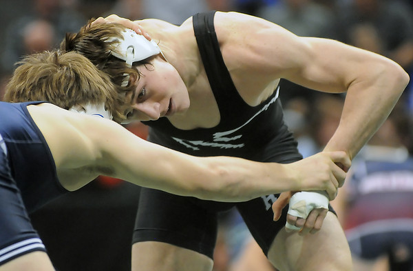 Roosevelt High School senior Blake Nygren, right, squares off against Broomfield's Connor King during their 160-pound semi-final match at the State Wrestling Championships on Friday, Feb. 19, 2010 at the Pepsi Center in Denver. Nygren won, 9-2.