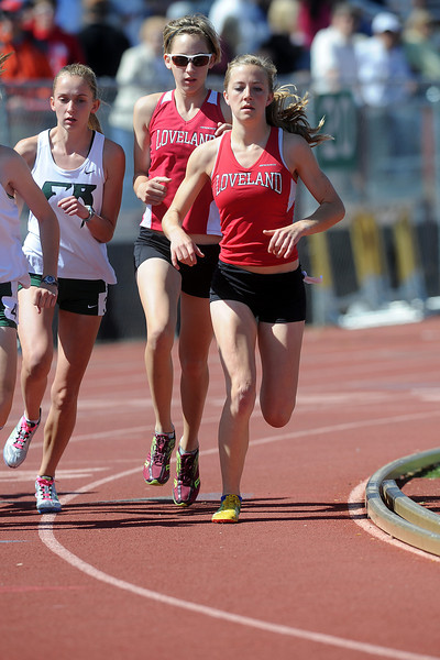 Loveland High School's Kailie Hartman, right, and Torrey Stephenson at the start of a heat of the girls 1600-meter run during the Rocky Ridge Invitational track meet on Friday, April 27, 2012 at French Field in Fort Collins.