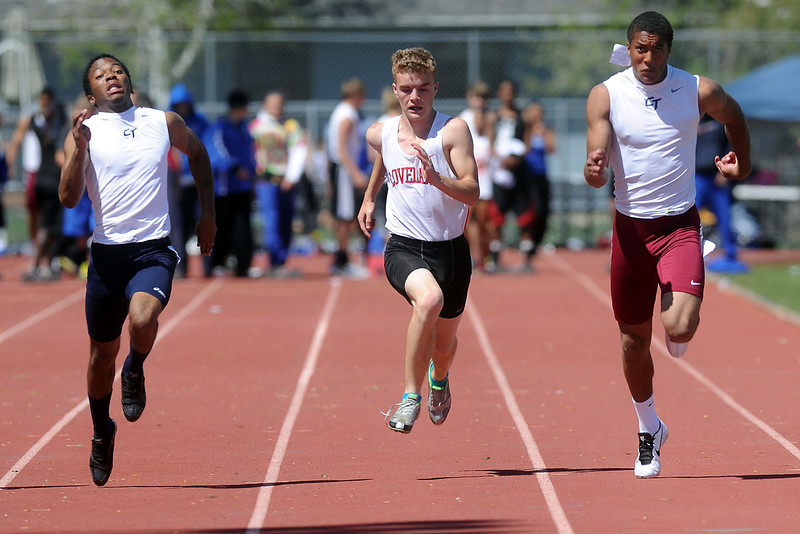 Loveland High School freshman Trevin Long, middle, competes in a heat of the 50-meter dash during the Rocky Ridge Invitational track meet on Friday, April 27, 2012 at French Field in Fort Collins.