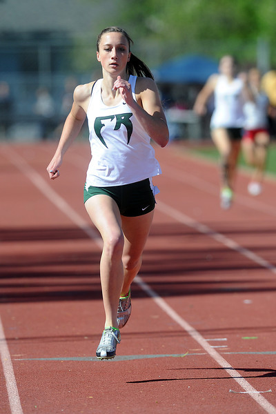 Fossil Ridge High School's Rhianna Williams competes in a heat of the 400-meter run during the Rocky Ridge Invitational track meet on Friday, April 27, 2012 at French Field in Fort Collins.
