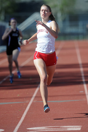 Loveland High School's Stefanie Tuder competes in a heat of the 400-meter run during the Rocky Ridge Invitational track meet on Friday, April 27, 2012 at French Field in Fort Collins.