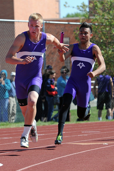 Mountain View High School senior Alex Montoya, right, passes the baton to teammate Josh Sandin in a heat of the 400-meter relay during the Rocky Ridge Invitational track meet on Friday, April 27, 2012 at French Field in Fort Collins.