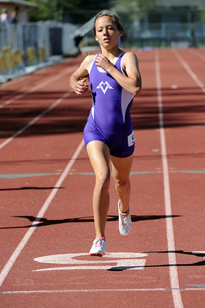 Mountain View High School's Katie Benner crosses the finish line while competing in a heat of the 400-meter run during the Rocky Ridge Invitational track meet on Friday, April 27, 2012 at French Field in Fort Collins.