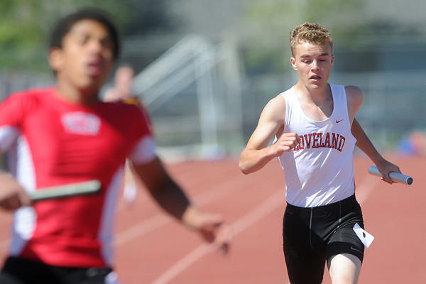 Loveland High School freshman Trevin Long, right, anchors a heat of the 800-meter relay during the Rocky Ridge Invitational track meet on Friday, April 27, 2012 at French Field in Fort Collins.