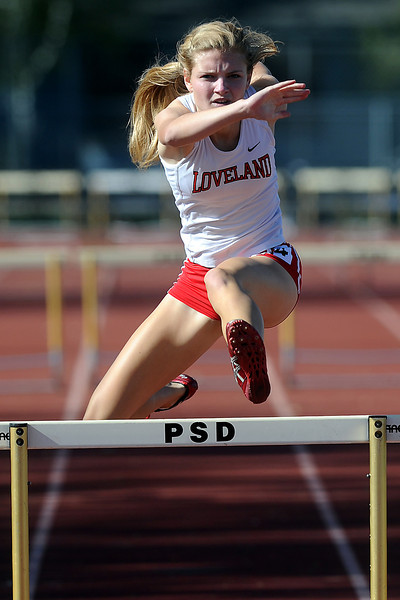 Loveland High School's Kaylee Packham competes in a heat of the 300-meter hurdles during the Rocky Ridge Invitational track meet on Friday, April 27, 2012 at French Field in Fort Collins.