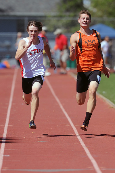 Loveland High School junior Dylan Miller, left, competes in a heat of the 50-meter dash during the Rocky Ridge Invitational track meet on Friday, April 27, 2012 at French Field in Fort Collins.