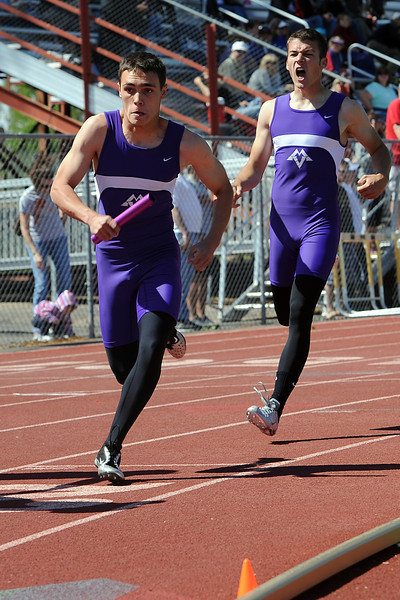 Mountain View High School's Nick Olson, right, yells encouragement to teammate Zack Mehn after passing the baton in a heat of the 800-meter relay during the Rocky Ridge Invitational track meet on Friday, April 27, 2012 at French Field in Fort Collins.