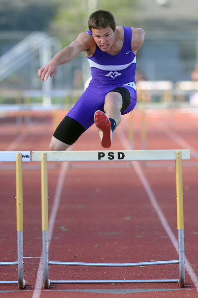Mountain View High School junior Tyler Kress clears the final hurdle while competing in the 300-meter hurdles during the Rocky Ridge Invitational track meet on Friday, April 27, 2012 at French Field in Fort Collins.