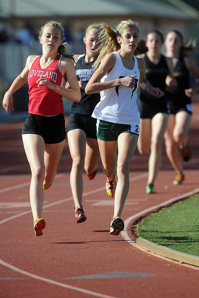 Loveland High School's Kailie Hartman, left, Mountain View's Riley Cooney and Fossil Ridge's Merrett Miller lead the pack after the first lap of the 800-meter run during the Rocky Ridge Invitational track meet on Friday, April 27, 2012 at French Field in Fort Collins.