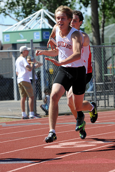 Loveland High School during a heat of the boys 800-meter relay for the Rocky Ridge Invitational track meet on Friday, April 27, 2012 at French Field in Fort Collins.