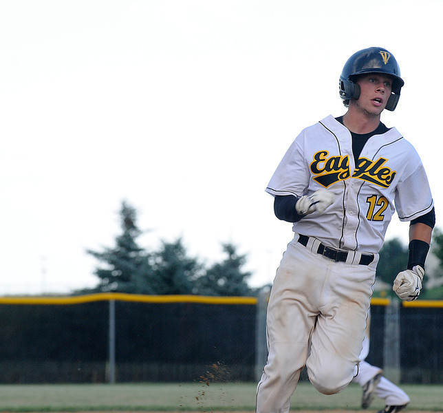12 rounds third base as Thompson Valley stages a rally in the third inning against Greeley West  on Sunday evening at Thompson Valley High School.