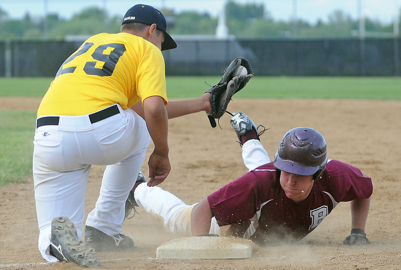 Berthoud's Luke Read dives back to first base to avoid the pick-off attempt by SLS Financial first baseman Josh Karlin in the top of the third inning of their game on Wednesday, June 2, 2010 at Constantz Field.