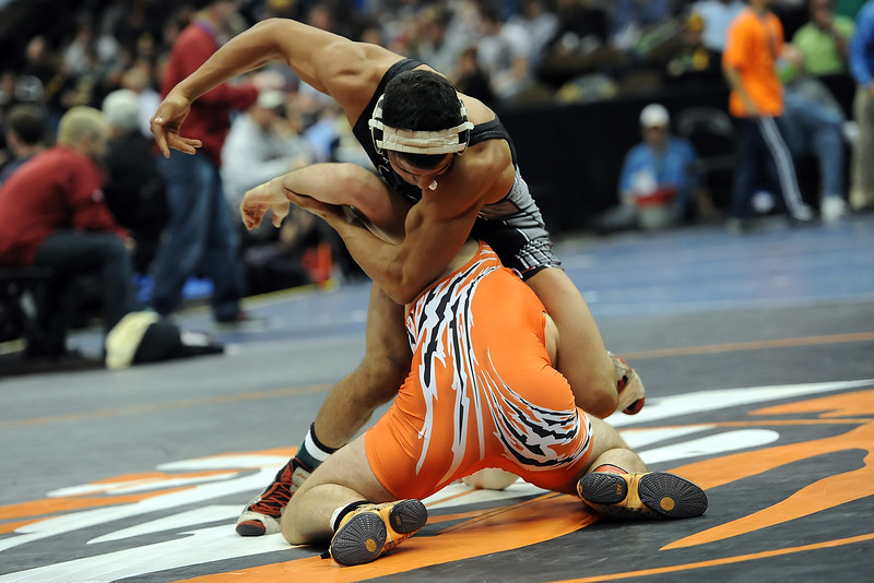 Roosevelt High School's Juan Sanchez, top, during his 170-pound semi-final match against Sterling's Luke Engelhaupt at the Class 4A State Wrestling Championships on Thursday, Feb. 16, 2012 at the Pepsi Center in Denver.