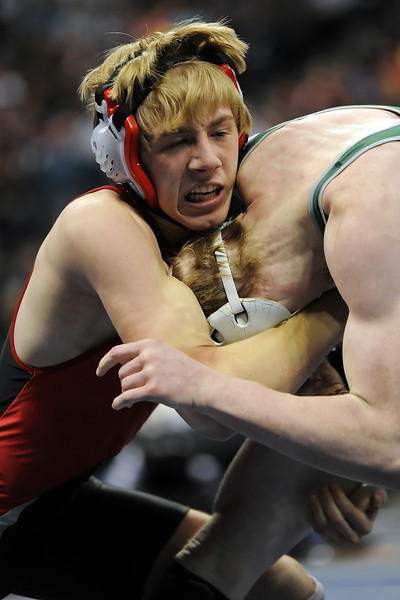 Loveland High School's Jordan Henrickson, left, battles against Fossil Ridge's Austen Lindsay in their 145-pound semi-final match during the State Wrestling Championships on Friday, Feb. 17, 2012 at the Pepsi Center in Denver.