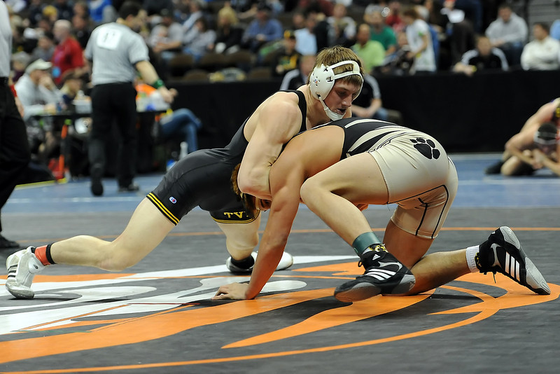 Thompson Valley High School's Cameron McCrimmon, left, grapples with Canon City's Miquel Montelongo during their 182-pound semi-final match at the State Wrestling Championships on Friday, Feb. 17, 2012 at the Pepsi Center in Denver.