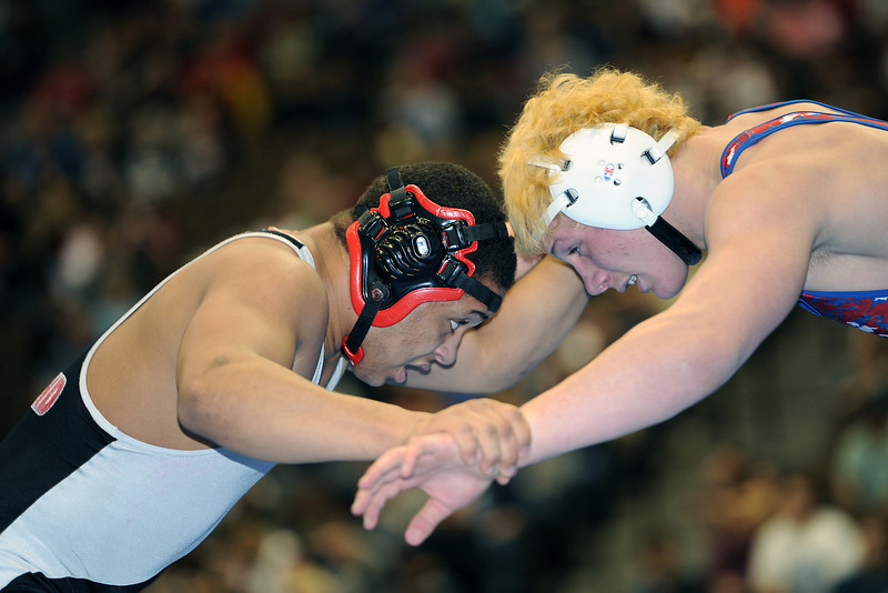 Loveland High School's Dalton Weis, left, during his 182-pound match against Fountain Valley's Josh Schoenberger at the Class 5A State Wrestling Championships on Friday, Feb. 17, 2012 at the Pepsi Center in Denver.
