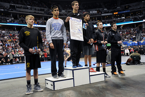 Thompson Valley High School junior Tanner Williams, left, stands at the awards podium after earning fifth place at 120-pounds in the Class 4A State Wrestling Championships on Saturday, Feb. 18, 2012 at the Pepsi Center in Denver.