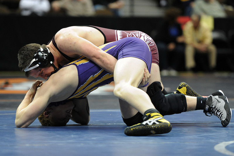 Berthoud High School's Cory Ellis, top, competes against Justin Briskey of Bayfield in their 182-pound match during the State Wrestling Championships on Thursday, Feb. 16, 2012 at the Pepsi Center in Denver. Ellis won by pin in the first period.