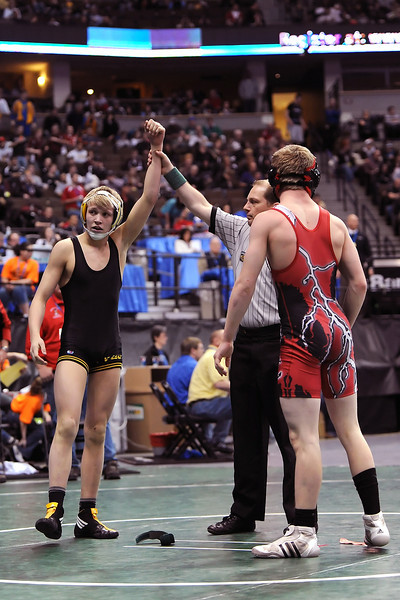 Thompson Valley High School junior Tanner Williams, left, after winning his consolation semi-final match during the Class 4A State Wrestling Championships on Thursday, Feb. 16, 2012 at the Pepsi Center in Denver.