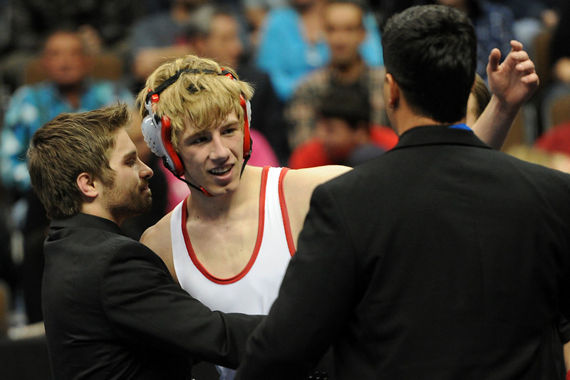 Loveland High School's Jordan Henrickson, middle, is congratulated by head coach competes against Ponderosa's John Lewis in the 145-pound championship match during the Class 5A State Wrestling Championships on Saturday, Feb. 18, 2012 at the Pepsi Center in Denver.