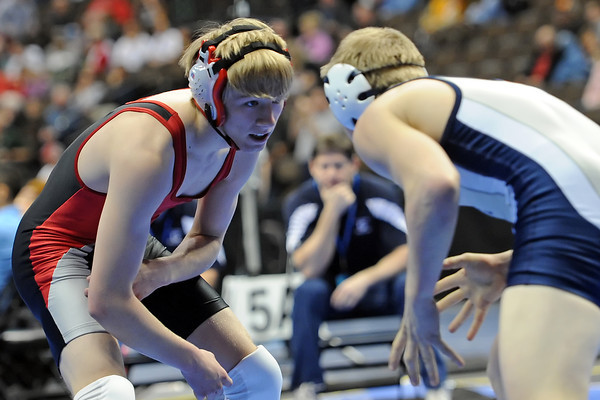 Loveland High School's Jordan Henrickson, left, squares off against Columbine's Hank Hammond during their 145-pound match for the State Wrestling Championships on Thursday, Feb. 16, 2012 at the Pepsi Center in Denver.
