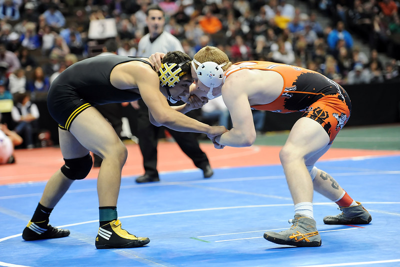 Thompson Valley High School's Francisco Marquez, left, squares off against Erie's Clay Bunker in their 152-pound semi-final match at the Class 4A State Wrestling Championships on Friday, Feb. 17, 2012 at the Pepsi Center in Denver.