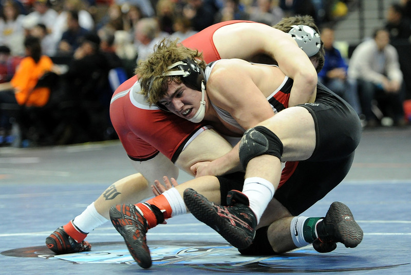 Loveland High School's Sam Kreimier, right, grapples with Willy Holdren of Grand Junction Central during their 152-pound match at the State Wrestling Championships on Friday, Feb. 17, 2012 at the Pepsi Center in Denver.