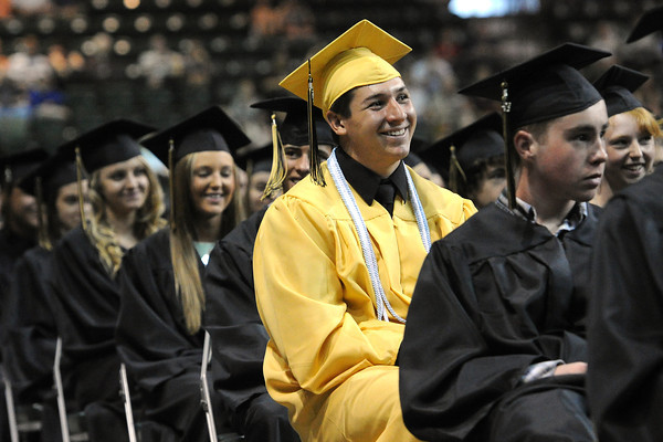Thompson Valley High School's Sam Baca, middle, sits with classmates during their graduation ceremony on Saturday, May 25, 2013 at the Budweiser Events Center.