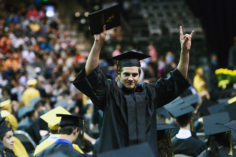 Thompson Valley High School's Nick Maki raises his hands in the air after picking up his diploma during the school's graduation ceremony on Saturday, May 25, 2013 at the Budweiser Events Center.
