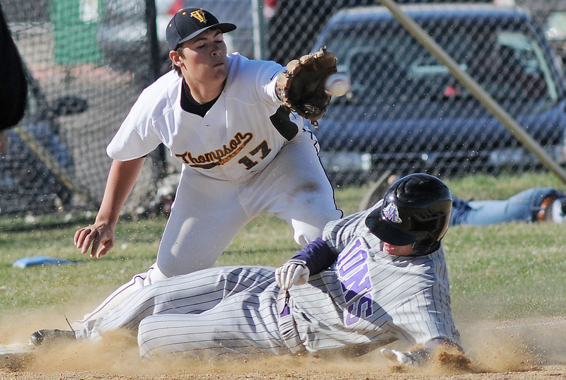 Mountain View High School's Joey Hlushak slides safely into third base for a triple ahead of the throw to Thompson Valley's Josh Karlin in the top of the fifth inning of their game Tuesday at Constantz Field. The Mountain Lions won in five innings, 10-0.