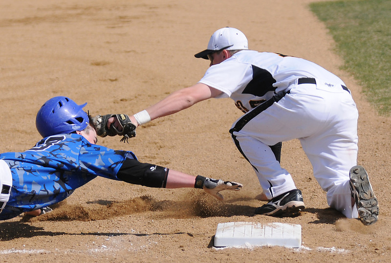 Thompson Valley High School third baseman Mike Lewis, right, tags out Broomfield baserunner Hayden Underberg on a steal attempt in the top of the second inning of their game Saturday, April 9, 2011 at Constantz Field. Thompson Valley lost, 18-9.