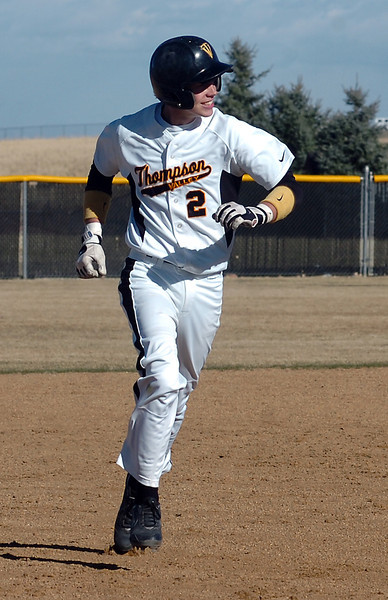 Thompson Valley's Chris Sievers #2 is all smiles as he rounds the bases after his second home run Thursday during their game against Silver Creek.