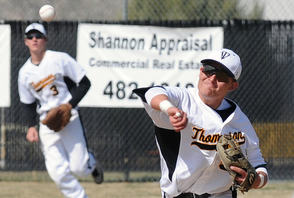Thompson Valley High School shortstop Chaz Moore, right, makes the throw to first base after fielding a grounder in the top of the third inning of a game against Broomfield on Saturday, April 9, 2011 at Constantz Field. Thompson Valley lost, 18-9.