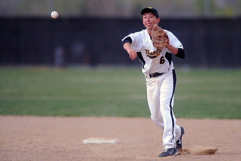 Thompson Valley High School shortstop Brad Soucek throws to first for an out after fielding a ground ball in the top of the sixth inning of a game against Roosevelt on Tuesday, April 17, 2012 at Constantz Field.