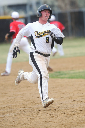 Thompson Valley High School baserunner Kyle Kelly advances to third base in the bottom of the fourth inning of a game against Loveland on Tuesday, April 3, 2012 at Constantz Field.