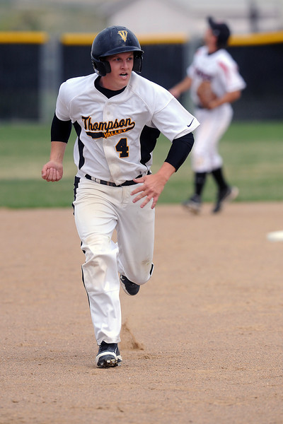 Thompson Valley High School senior Jeremy White sprints to third base on his way to scoring in the bottom of the fourth inning of a game against Roosevelt on Tuesday, April 17, 2012 at Constantz Field.