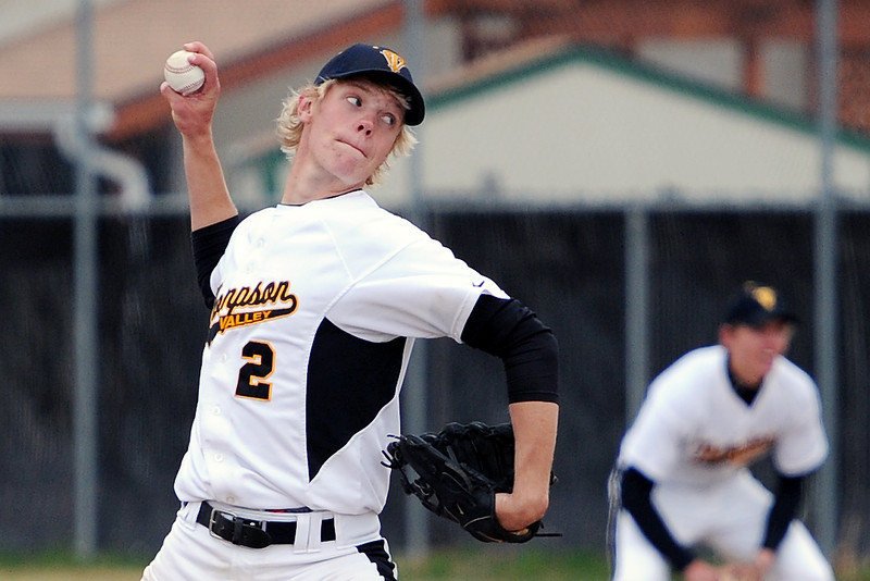 Thompson Valley High School's Chris Sievers winds up before throwing a pitch in the top of the third inning of a game against Loveland on Tuesday, April 3, 2012 at Constantz Field.
