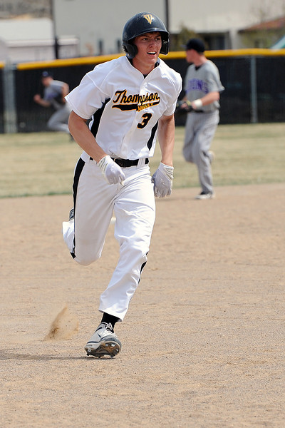 Thompson Valley High School's Karsen Buschjost advances to third base on a single by teammate Teague McFadden in the bottom of the seventh inning of a game against Mountain View on Saturday, March 31, 2012 at Constantz Field.