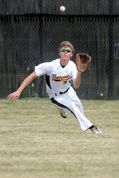 Thompson Valley High School center fielder Karsen Buschjost tracks down a fly ball for an out in the top of the fifth inning of a game against Mountain View on Saturday, March 31, 2012 at Constantz Field.