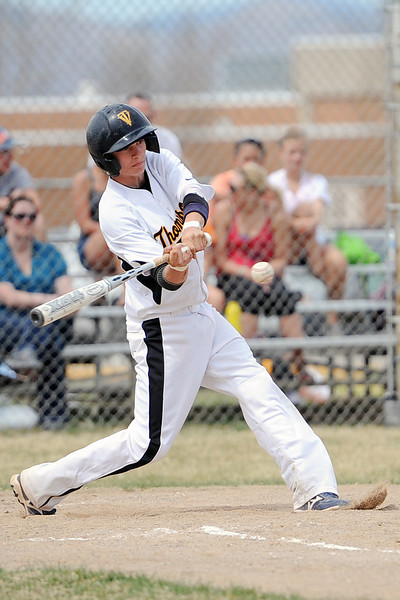 Thompson Valley High School's Garrett Smith swings at a pitch in the bottom of the third inning of a game against Mountain View on Saturday, March 31, 2012 at Constantz Field.