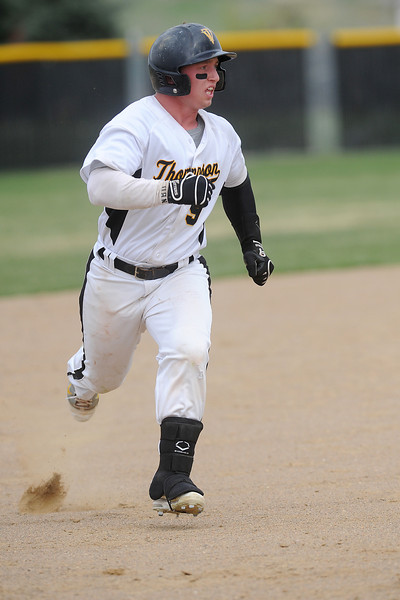 Thompson Valley High School's Kyle Kelly runs to third base in the bottom of the fourth inning of a game against Roosevelt on Tuesday, April 17, 2012 at Constantz Field.