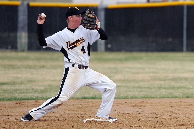 Thompson Valley High School's Jeremy White steps on second base to start a double play in the top of the second inning of a game against Loveland on Tuesday, April 3, 2012 at Constantz Field.