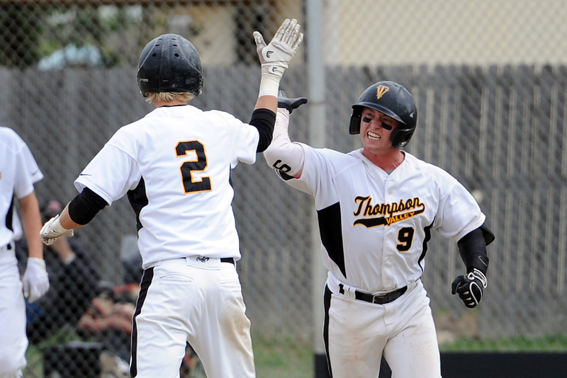 Thompson Valley High School senior Kyle Kelly, right, is congratulated by teammate Chris Sievers after scoring a run in the bottom of the fourth inning of their game against Roosevelt on Tuesday, April 17, 2012 at Constantz Field.