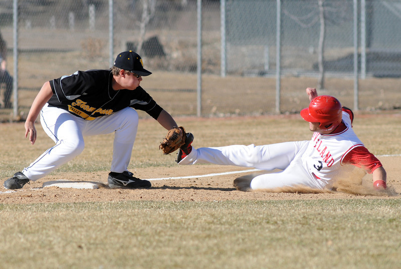 Thompson Valley High School third baseman Josh Karlin puts the tag on Loveland's Trent Lussenhop in the bottom of the first inning of their game on Tuesday, March 16, 2010 at Swift Field. Loveland won, 14-4, in the fifth inning.