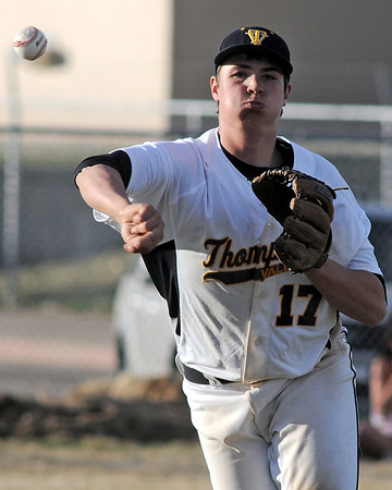 Thompson Valley High School third baseman Josh Karlin makes the throw to first base after fielding a hit in the top of the seventh inning of a game against Northridge on Tuesday, March 30, 2010 at Constanz Field. The Eagles lost, 19-11.