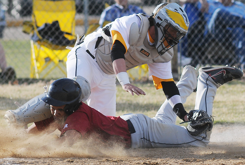 Thompson Valley High School catcher Max Schoen tags out Northridge's Eddie Rodriguez at home plate in the top of the sixth inning of their game on Tuesday, March 30, 2010 at Constanz Field. The Eagles lost, 19-11.