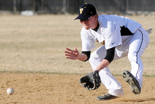 Thompson Valley High School shortstop Chaz Moore fields a ground ball in the top of the sixth inning of a game against Northridge on Tuesday, March 30, 2010 at Constanz Field. The Eagles lost, 19-11.