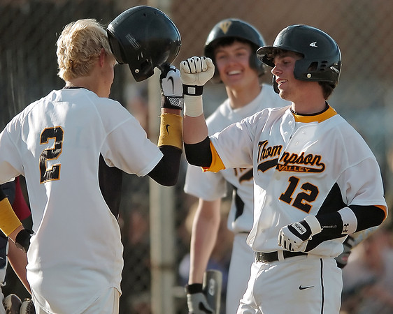 Thompson Valley High School junior Max Schoen, right, is congratulated by teammate Chris Sievers after hitting a homerun in the bottom of the sixth inning of a game against Northridge on Tuesday, March 30, 2010 at Constanz Field. The Eagles lost, 19-11.